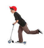Boy  leaning forward and pushing the scooter with one foot  poster