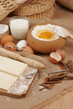 Rolling pin and dough for baking with scattered flour poster