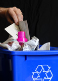 hand putting recycling in bin with plastic and paper poster