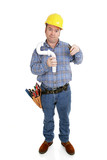 Confused construction worker using wrong tool on pipe poster