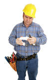 Electrician having trouble assembling plumbing pipe. Isolated poster