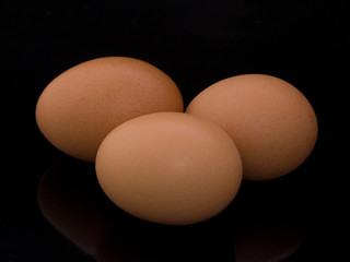 Three eggs on black isolated