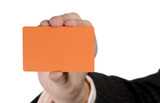 Blank Orange Visit Card in hand. Isolated on white poster