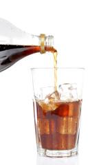Pouring soda, reflected on white background. Shallow DOF