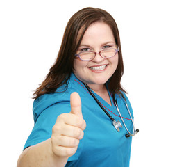 Happy, pretty nurse giving a thumbs-up sign.  Isolated