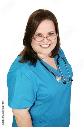 Beautiful plus sized woman in nursing scrubs.  Isolated