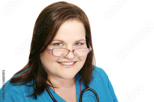 Closeup headshot of a friendly, beautiful nurse.  Isolated