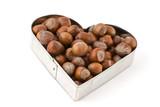 hazelnuts in heart shaped form poster