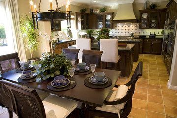 Estate kitchen with breakfast table and decor.