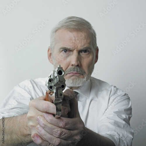 Old man with handgun