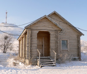 Russian wooden small house in the winter