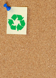 corkboard with recycle symbol on thumb tacked note.. poster