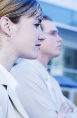profile view of businesspeople looking forward