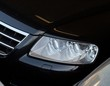 Closeup of the headlights of a black car