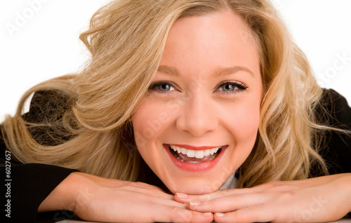 Smiling Blonde Woman Laying on her Desk