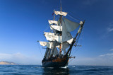 HMS Surprise Sailing Ship at Sea under full sail - 6041256