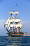 HMS Surprise Sailing Ship at Sea under full sail  - 6041279