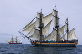 Tall Ship at Sea under full sail with ships in the background. - 6041400