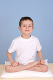 6 years old boy relaxing on blue background poster