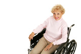 Pretty senior woman with positive attitude in a wheelchair.  poster