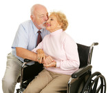 Affectionate senior husband giving his disabled wife a kiss  poster