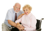 Attractive senior couple - the wife is in a wheelchair.  poster