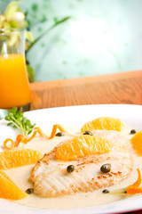 Grilled skate (ray) with orange and caper sauce