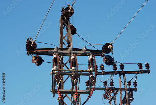 Detail of electrical pylon over blue sky