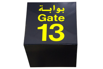 Ceiling sign of gate 13 (thirteen) in Arabic and in English.