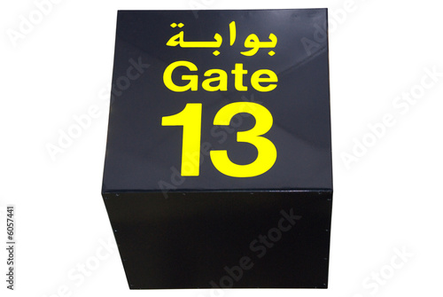 Poster Ceiling sign of gate 13 (thirteen) in Arabic and in English.
