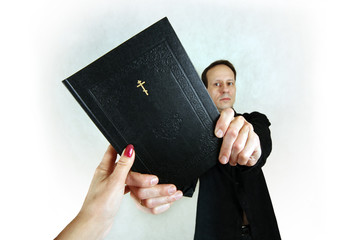 The man transfers the woman the bible