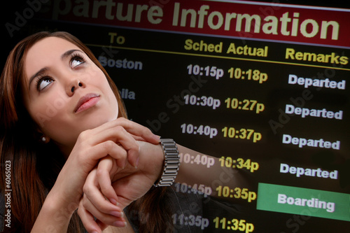 poster of A pretty business woman traveling looking at departure times