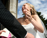 A happy bride embraces her new husband
