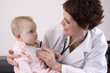 Female physician listening to a baby with a stethoscope.