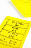 Yellow ticket stub, closeup on light background poster