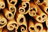 Big pile of spicy cinnamon sticks - macro poster