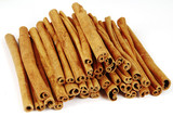 Big pile of spicy cinnamon sticks isolated poster
