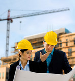 Fototapety Architects reading blueprint