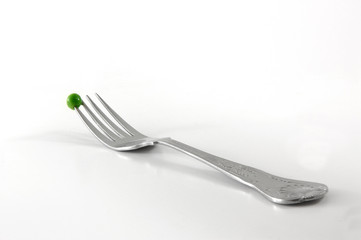 single pea on fork