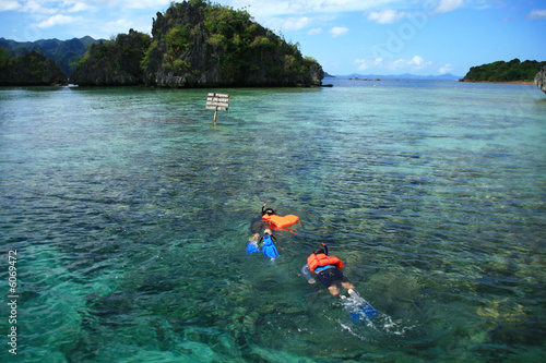 two snorkelers exploring the beauty of underwater marine life