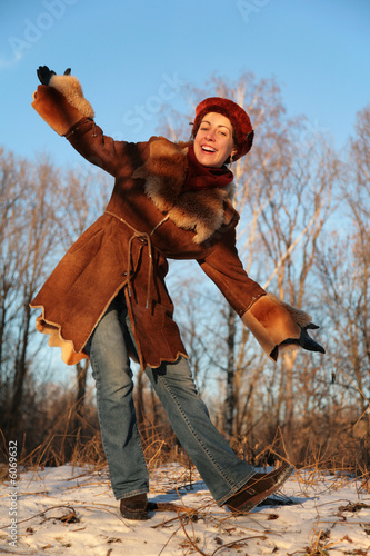 young pretty woman posing outdoor in winter