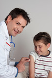 A child receives an immunisation or vaccination shot. poster