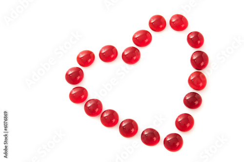Red gem stones in a heart shape