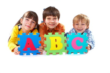 Children with Alphabet Puzzle