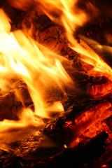 Macro of hot embers in fire.