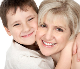 Mother and son. Isolated over white background.