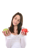 A pretty, healthy woman deciding between two apples poster