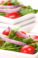 Watercress salad with cherry tomatoes, red onions
