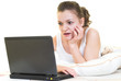 Young girl is surprised in the bed with laptop. Isolated.