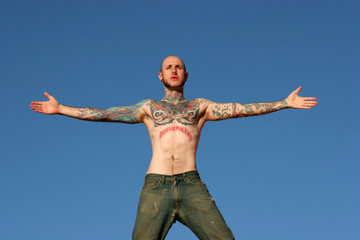 Male model with tattoos on his body